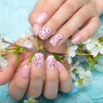 Spring manicure for the bride in gentle tones with flowers. Nail Design.